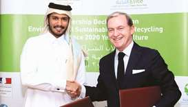 French ambassador Gellet and Elite Paper Recycling chairman al-Suwaidi after signing the partnership