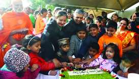 Indian ambassador P Kumaran along with students and community members cutting a cake to mark the 71s