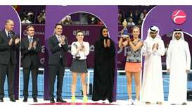 Elise Mertens poses with the trophy alongside HE Sheikha Hind bint Hamad al-Thani