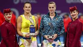 Aryna Sabalenka (C-L) of Belarus and Petra Kvitova (C-R) of Czech Republic pose with their trophies