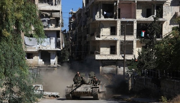 Syrian pro-government forces take part in an operation to take control of Aleppo