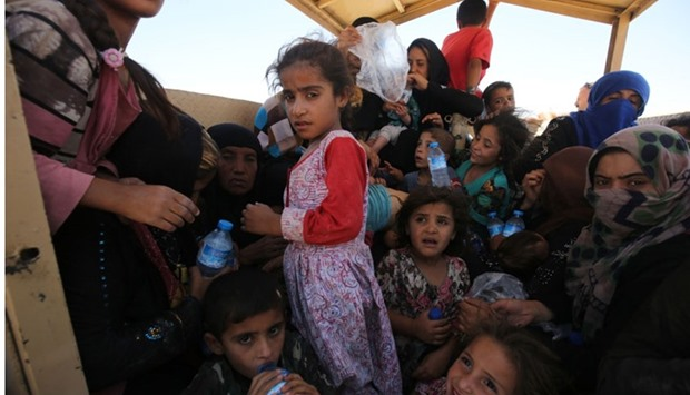 Iraqi women and children who fled the towns of al-Shirqat and Qayyarah
