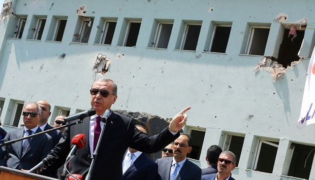 Turkey's President Tayyip Erdogan addresses the audience as he visits the Turkish police special for