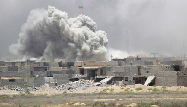 Smoke rises from clashes with Islamic State militants