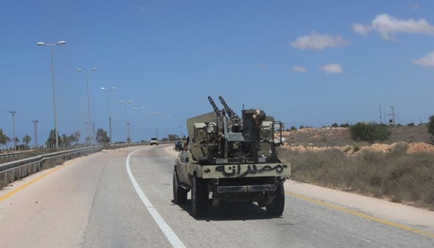 A fighter from Libyan forces allied with the U.N.-backed government drives a military truck in Sirte