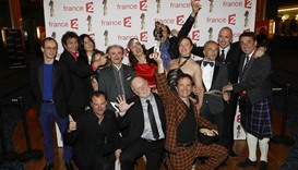 "Actors of the play ""Les Faux British"" pose after receiving the Moliere Award"