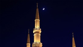 A crescent moon is seen above al Amin mosque in Beirut, Lebanon