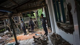 Police stand guard around the destroyed mosque at Thuye Tha Mein village in Bago province