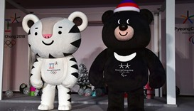 Soohorang and Bandabi stand on a stage-Hoenggye elementary school, Pyeongchang