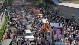 Thousands of people take part in a funeral procession for Kem Ley in Phnom Penh.