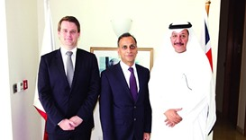 Sheikh Abdullah bin Ali bin Jabor al-Thani and Mark Melvin with ambassador Ajay Sharma at the signin