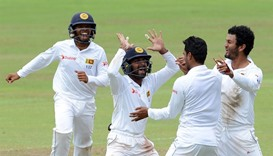 Sri Lanka's celebrates after dismissed Australia's Peter Nevill during the fifth and the final day o