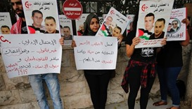 Palestinians hold posters of Palestinian prisoner Bilal Kayed, who has been on hunger strike for 71