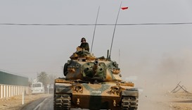 A Turkish army tank drives towards to the border in Karkamis on the Turkish-Syrian border