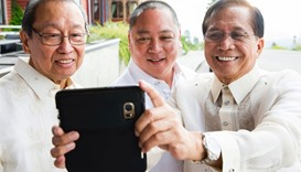 Jose Maria Sison (L),  Joey Fornier and Jesus Dureza make a selfie