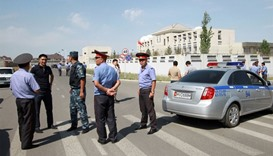 Security forces gather near the site of a bomb blast outside China's embassy in Bishkek