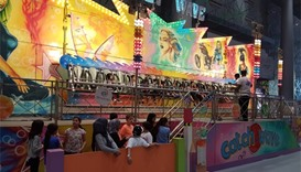Children enjoying thrill rides at the Entertainment City