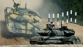 T-72 tanks, operated by crews from Kuwait (front) and Nicaragua, drive during the Tank Biathlon comp