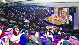 The audience enjoying a concert at the Souq Waqif theatre