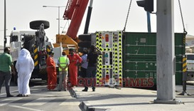 The trailer was turning into Rawdat Al Khail Road when it overturned