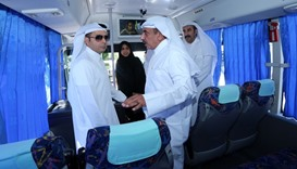 Minister of Transport and Minister of Education inside a new school bus
