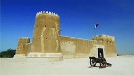 A man enters the historic Fort Zubara
