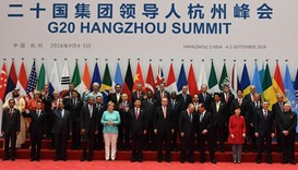 China's President Xi Jinping (C) and G20 leaders pose for family photo in Hangzhou