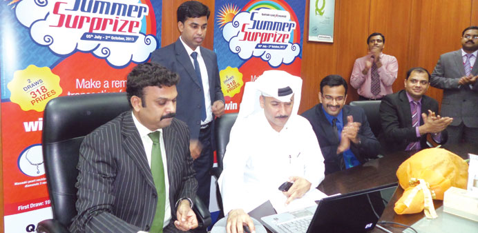 Officials pick the winning entries at the Qatar UAE Exchange draw.
