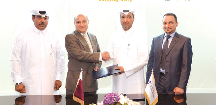 Officials of Doha Bank and Al Jaber Watches at the signing ceremony.