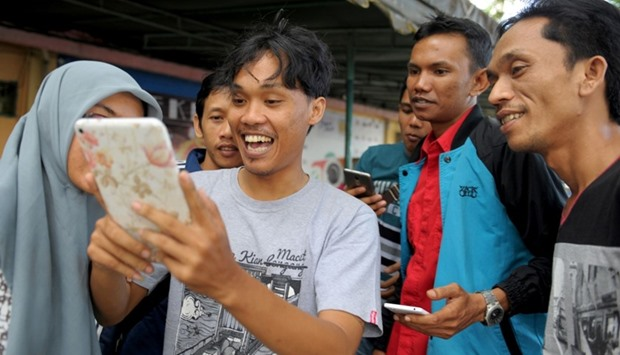 A group of Indonesians playing Pokemon Go on the streets in Banda Aceh