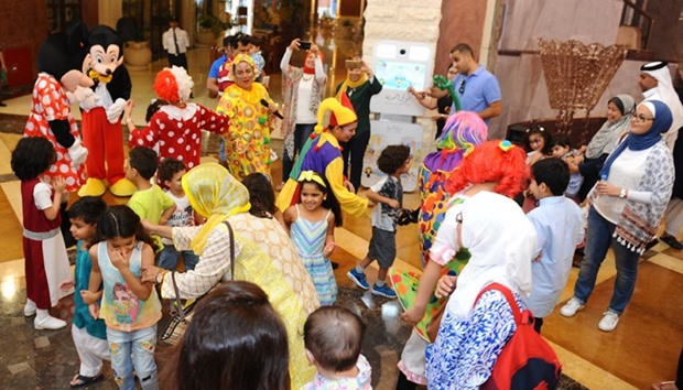 Mickey and Minnie Mouse, entertain children at Souq Al Medina in The Pearl-Qatar.