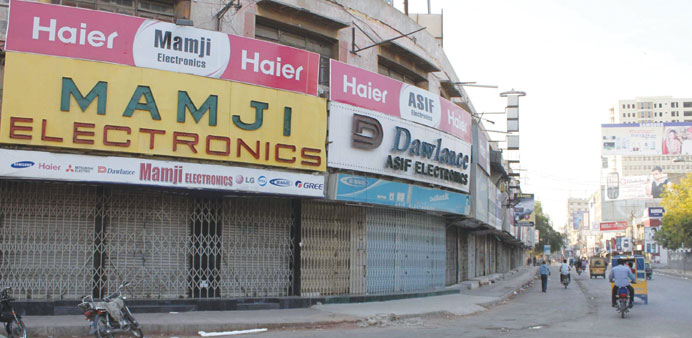 A view of a closed market in restive Karachi, yesterday. Several parts of the country's financial hu