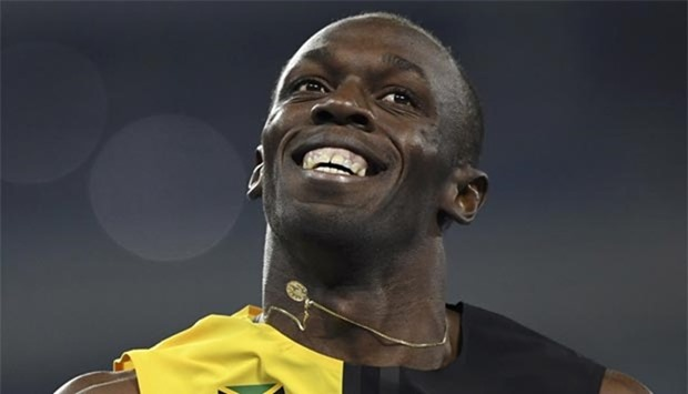 Usain Bolt celebrates after winning the race