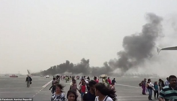 Picture posted in social media shows the evacuated passengers running from the plane