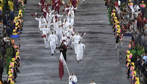 Qatar's flagbearer Sheikh Ali Khalid al-Thani  and the team
