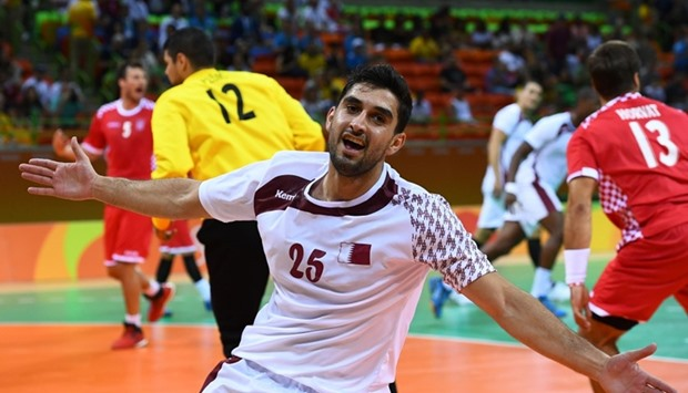 Qatar's Kamal Aldin Mallash celebrates a goal. Men's Preliminary Group A Handball