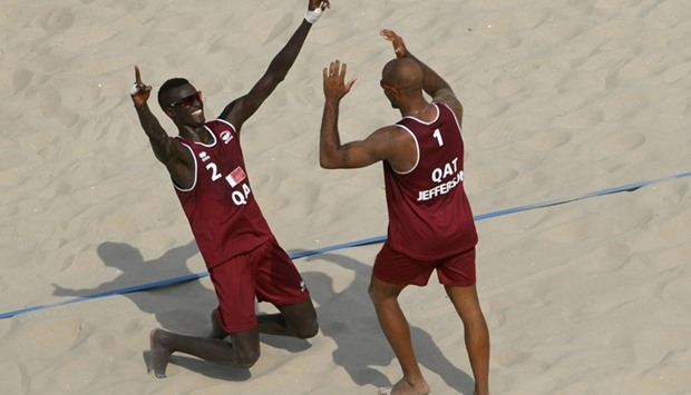 Jefferson Santos Pereira and Cherif Younousse Samba (Qatar) celebrate,