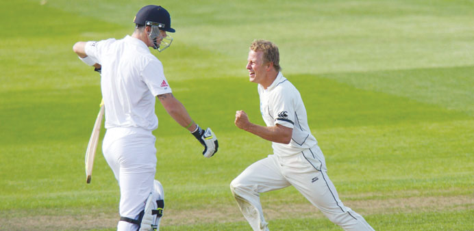 New Zealand's Neil Wagner (R) celebrates after claiming England's Kevin Pietersen leg before wicket