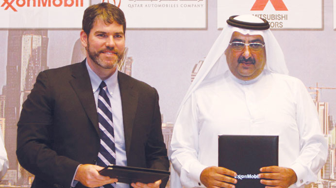 ExxonMobil Qatar Inc president and general manager Bart Cahir (left) and Qatar Cycling Federation pr