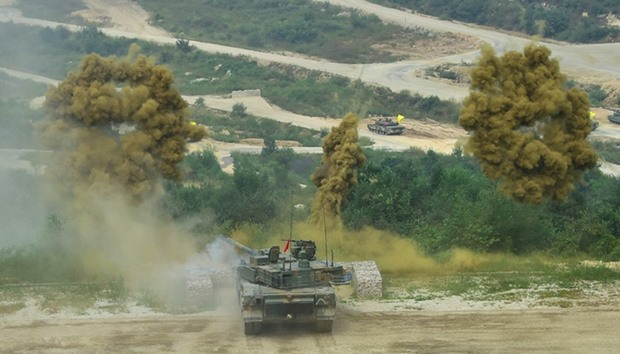 A South Korean K2 tank fires smoke shells during a live fire demonstration for a media preview