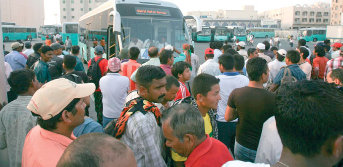 Passengers at the central bus station in Doha.