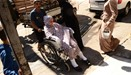 A wounded Syrian woman is wheeled into a hospital after she was hit by mortar shells that targeted A
